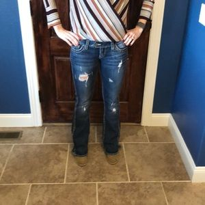 Silver distressed dark wash boot cut jeans 26x33.